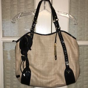 Cole Haan straw type handbag with blue interior